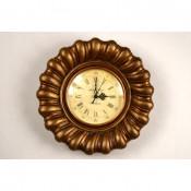 Reloj bronce marrón números romanos